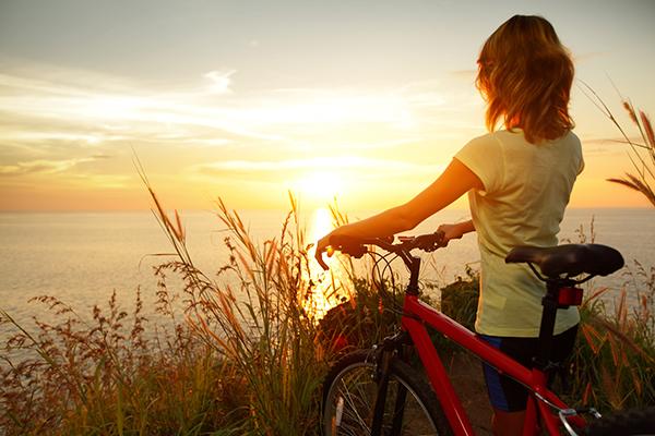 women on bike happy
